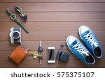 travel accessories on wooden... | Shutterstock . vector #575375107