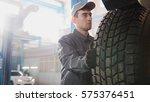 car service   a mechanic checks ... | Shutterstock . vector #575376451