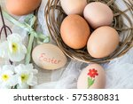 hen's egg with text easter and... | Shutterstock . vector #575380831