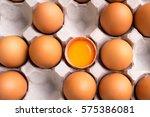 Fresh Brown Eggs With Yolk On...