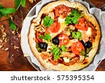 pizza on wooden background | Shutterstock . vector #575395354