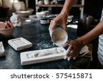 young woman making a ceramic...   Shutterstock . vector #575415871
