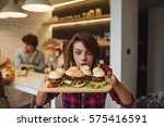 woman can't wait to eat all the ... | Shutterstock . vector #575416591