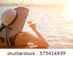 young woman sunbathing tanning... | Shutterstock . vector #575416939