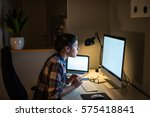 Small photo of Young businesswoman working on the computer at late night shift.