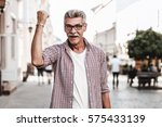 happy winner. cheerful senior... | Shutterstock . vector #575433139