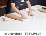 roll out the dough. closeup... | Shutterstock . vector #575439604