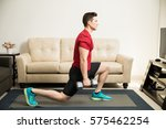 profile view of a young and fit ... | Shutterstock . vector #575462254
