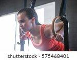 Young Athlete Holding Gymnasti...
