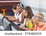 schoolgirls using computer in... | Shutterstock . vector #575480929