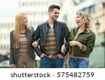 group of young people having... | Shutterstock . vector #575482759
