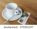 empty espresso cup in cafe with ... | Shutterstock . vector #575501197