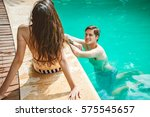 young couple in the pool | Shutterstock . vector #575545657