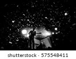 frontman silhouette on a stage...   Shutterstock . vector #575548411