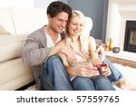 couple looking at pictures on... | Shutterstock . vector #57559765