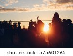 sunset beach party dancers... | Shutterstock . vector #575601265