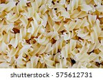 fusilli dry pasta background... | Shutterstock . vector #575612731