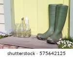 green wellington boots sitting... | Shutterstock . vector #575642125