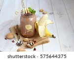 banana chocolate smoothie with... | Shutterstock . vector #575644375