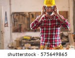 adult carpenter with protective ... | Shutterstock . vector #575649865
