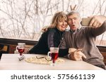 embraced old couple taking a... | Shutterstock . vector #575661139