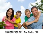 united family in the park | Shutterstock . vector #57568378