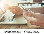online payment man's hands...   Shutterstock . vector #575698027