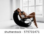 sexy woman in black lingerie on ... | Shutterstock . vector #575731471