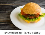 hamburger on a wooden table in... | Shutterstock . vector #575741059