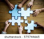 group of people holding puzzle... | Shutterstock . vector #575744665