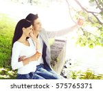 young beautiful couple having a ... | Shutterstock . vector #575765371
