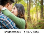 couple embraces on the road. | Shutterstock . vector #575774851