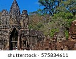 Small photo of Fifty-four images of demon gods (Asuras) push tail of mythical serpent (Naga) on right side of Mythic statues line causeway over moat leading to south gate of Angkor Thom, Angkor, Siem Reap, Cambodia