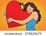 beautiful young woman hugging... | Shutterstock .eps vector #575835679
