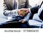 businessman shaking hands to... | Shutterstock . vector #575883655