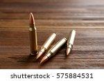 bullets on wooden background | Shutterstock . vector #575884531