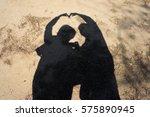 silhouette heart hands couple | Shutterstock . vector #575890945