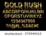 Gold rush. Gold alphabetic fonts and numbers on a black background. Vector illustration | Shutterstock vector #575949415