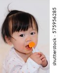 adorable asian baby girl ... | Shutterstock . vector #575956285