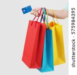 woman with shopping bags and...   Shutterstock . vector #575984395
