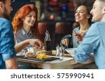 Friends  talking and having fun at dinner party. Selective focus and small depth of field. - stock photo