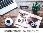 world map with laptop on wooden ... | Shutterstock . vector #576014374
