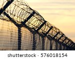 Barbed wire steel wall against...