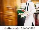 Waiter serving in motion on...