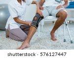 physiotherapist examining...   Shutterstock . vector #576127447