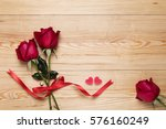 Red Roses And A Heart On Woode...