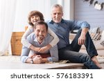 delighted cute boy hugging his...   Shutterstock . vector #576183391