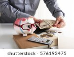 piggy bank with money | Shutterstock . vector #576192475