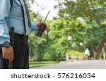 security guard hand holding cb... | Shutterstock . vector #576216034