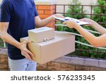 pedestrian courier gives order... | Shutterstock . vector #576235345